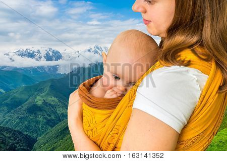 Happy Mother With Her Baby In A Sling