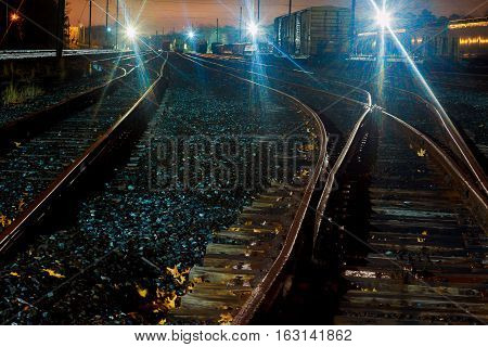 Cargo train platform at night. Railroad in Ukraine. Railway station. railway station wagons night