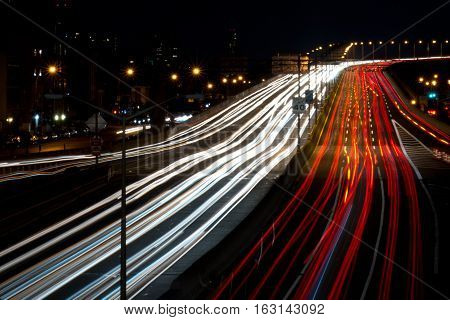 Light streaks on a busy highway in New York City.