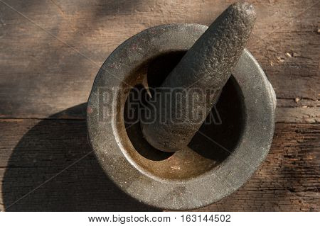 old granite stone mortar and pestle are Thai cooking tool