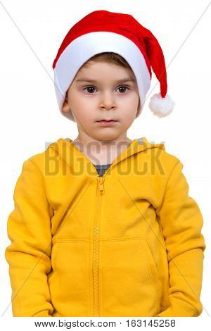 little boy wearing on red Santa helper hat. Isolated over white background