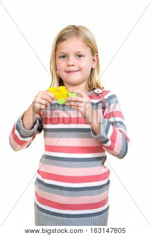 Little girl with a toy, Isolated on white.