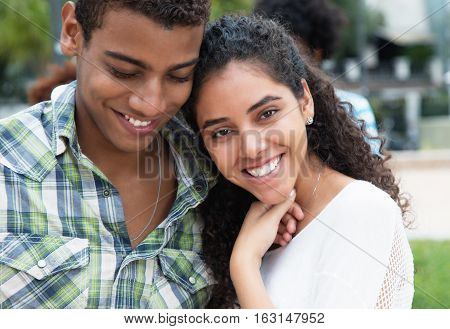 Love couple in arms in vacation in the summer