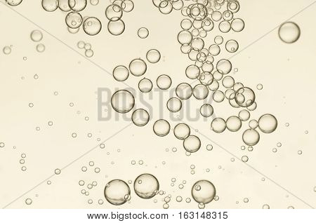 Beautiful water bubbles flows over a blurred background