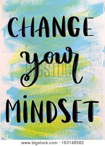 Change your mindset motivational message on blue painted background