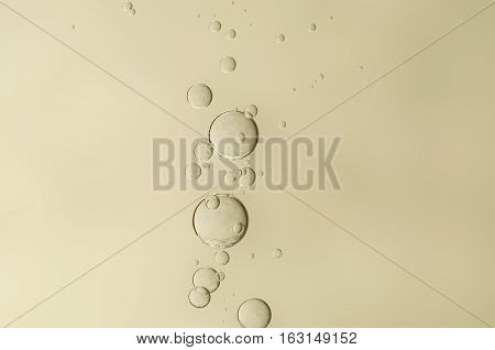 Beautiful air bubbles flows over a blurred background