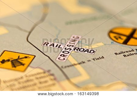 rail road crossing warning sign on a map
