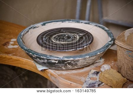 An empty circle where the potter molds product. Creative studio potter. Workplace wizard Crock pottery