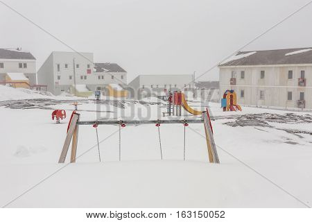 Harsh greenlandic childhoodplayground covered in snow and ice in Nuuk city Greenland
