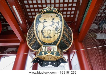 giant black and gold lantern in Japanese temple