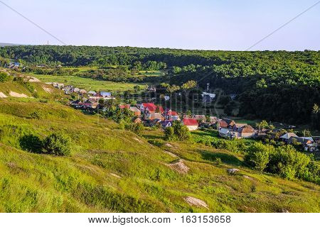 Russian village in a valley between the forest and the ancient Cretaceous deposits