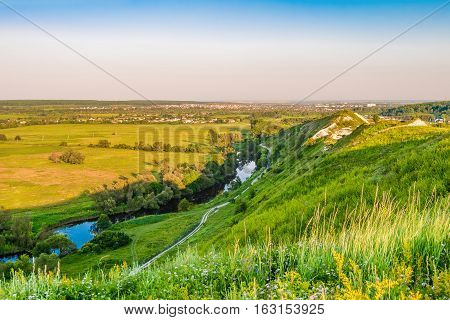 View of plain and river valley from a high hill. Town Shebekino on the horizon.