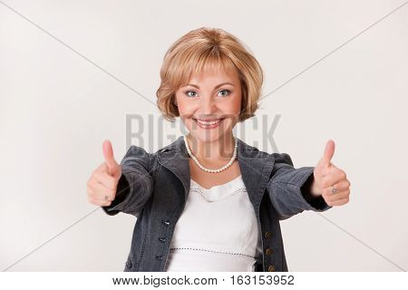 Young Woman In A Jacket On A Studio Background