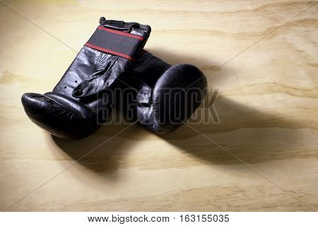 Pair of Boxing Gloves on Wooden Background