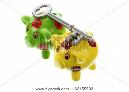 Piggy Banks and Key on White Background
