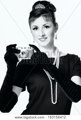 Portrait Of A Beautiful Young Elegant Woman With A Vintage Camera