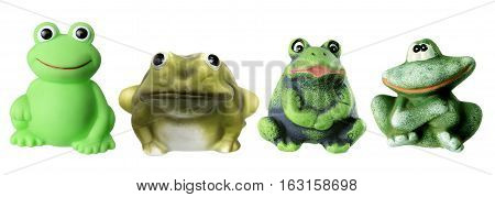 Row of Toy Frogs on White Background