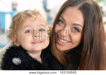 mother with little daughter, close up portrait