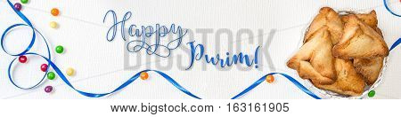 Purim banner with traditional cookies - hamantaschen and holiday greeting english text - Happy Purim