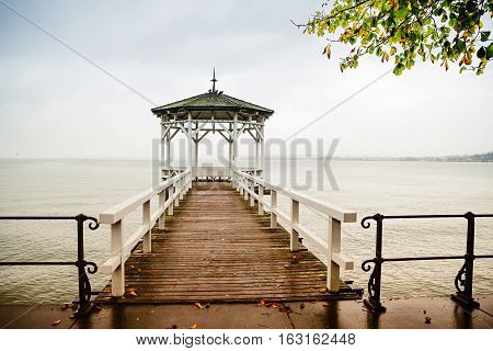 lonely pier at lake constance wooden bridge to pavilion germany