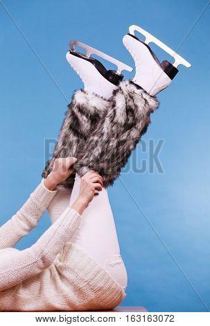 Woman Legs Wearing Ice Skates Fur Socks, Skating
