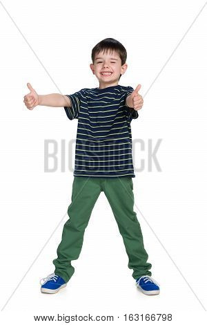 Young Boy In A Green Trousers Holds His Thumbs Up