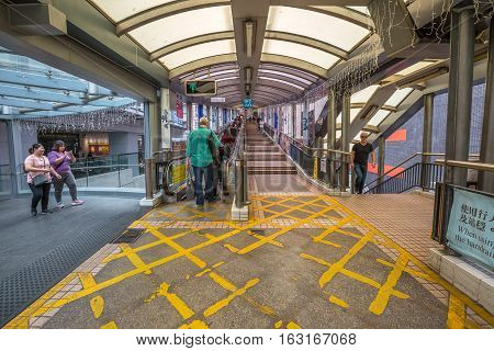 Hong Kong, China - December 4, 2016: the beginning of popular Mid-Levels escalator and walkway system on Queen's Road Central in Hong Kong, the longest outdoor covered escalator system in the world.