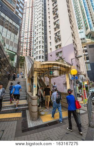 Hong Kong, China - December 4, 2016: The final section of Central-Mid-levels escalator, runs from Mosque Street, and is linked by footbridge over Robinson Road and walkways up to end in Conduit Road.