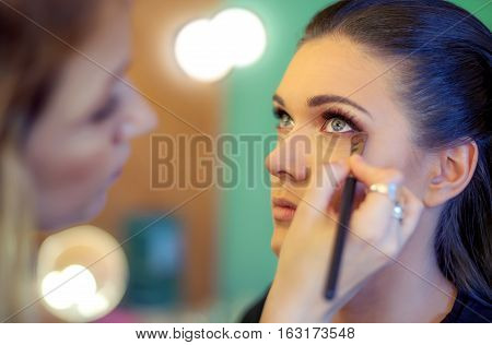 Makeup Artist Applying Eyeshadow