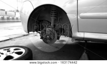 Car wheel hub for service change the tire or max Photography mono tone black and white and around at center of the circle are blur.