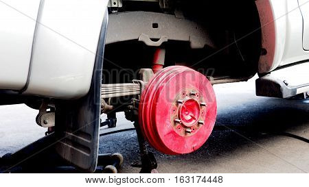 Pickup truck wheel hub red color for service change the tire or max.