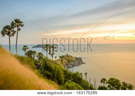 Promthep Cape is a mountain of rock that extends into the sea view point sunset at Phuket Thailand