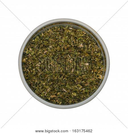 Oregano spices - Dried oregano for culinary use in a small dish isolated on a white background