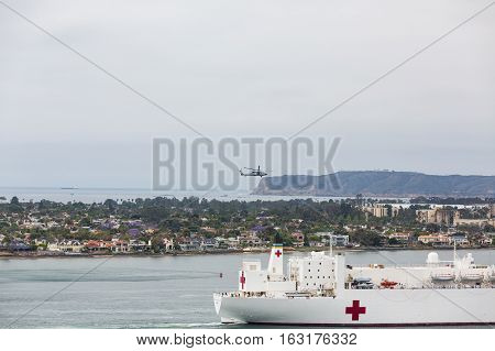 United States Naval Ship Mercy sailing into San Diego Harbor