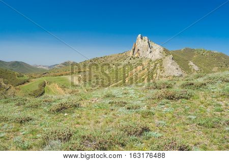 Spring landscape with Frog mountain near Sudak town in Crimea Ukraine.