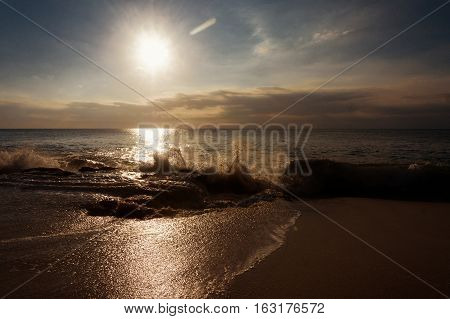 Sea sunset surf great wave break on sandy coastline