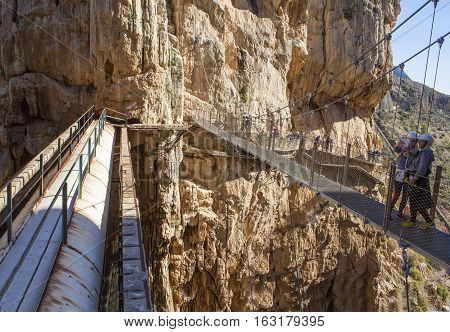 Malaga Spain - December 6 2016: people walking along the Caminito del Rey path Malaga Spain. They are taking pictures to theirselves over the suspension bridge of the gorge