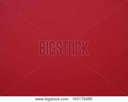 Blurred red paper surface useful as a background