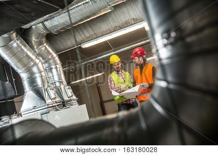 Portrait of a worker constructing and checking development of a small business hall. Reliable civil engineer working on a construction site foreman at work