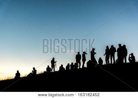 Group Of People On Peak Mountain.