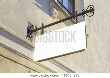 Signboard on the wall. Mock up rectangular shape. Oldtown view