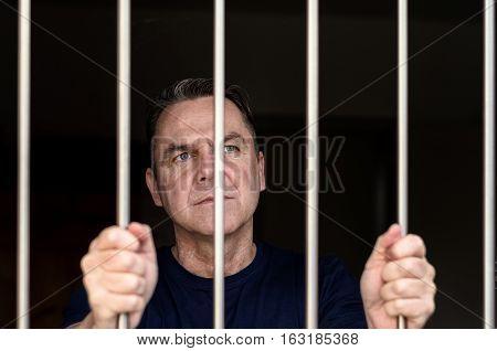 Middle Aged Blue Eyed Man Incarcerated
