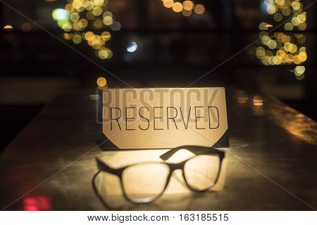 Gold plate reserve and glasses. Stylish photo with glasses