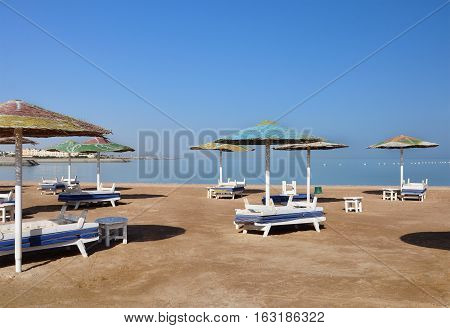 Parasols and sun loungers on the beach in Egypt. Nobody