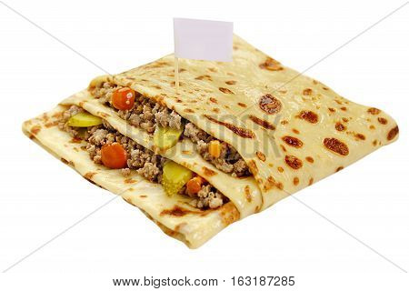 Pancake in a form of a pocket stuffed by forcemeat with vegetables and greenery white background close up view