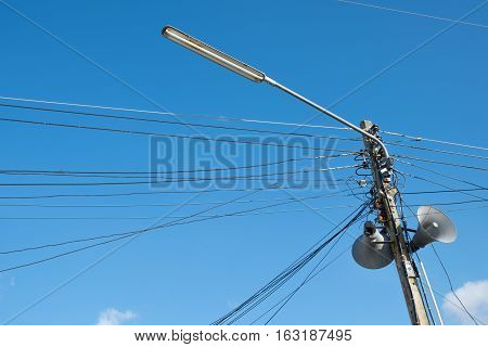 electric pole power lines and Loudspeaker on blue sky background