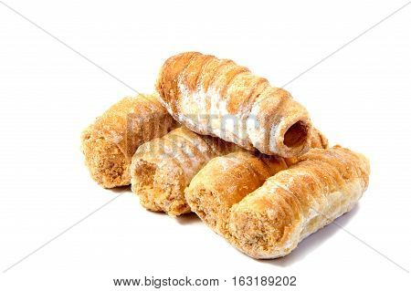Rolls with cream on a white background.