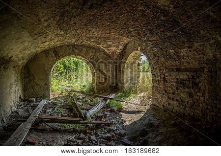 Old ruined lower cellar floor under ruined mansion of Earl Voeikov