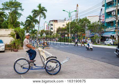 Nha Trang, Vietnam. May 8, 2015: The friendly rickshaw on the streets of Nha Trang