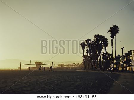 Venice beach walk at sunset with beach volley in the background